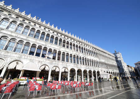 nuove: VENICE, VE, ITALY - January 31, 2015:bar tables and the palazzo delle Procuratie Nuove in Venice during high tide with St. Marks square under water