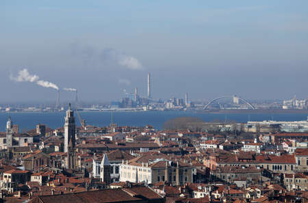 smokestacks: smokestacks and factories polluting with smoke near Venice in Italy