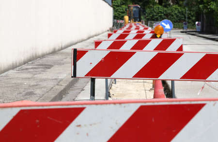 roadwork: hurdles in the construction site during the roadworks for the laying of optical fibre