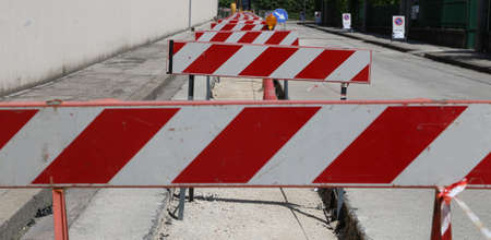 hurdles in the construction site during the roadworks for the laying of optical fibre photo