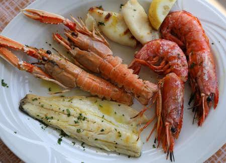 norvegicus: grilled fish with shrimp and lemon
