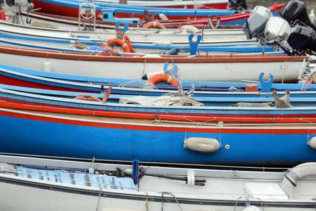 motor boats: many rowing boats and motor boats moored at the pier Stock Photo