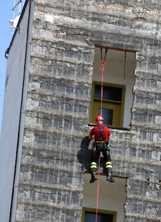 rappelling: professional climber training during rappelling