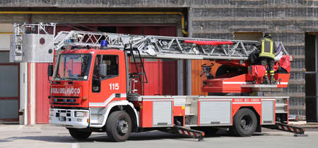 accident fire truck: big truck with metal scale of firefighters in the Firehouse Editorial