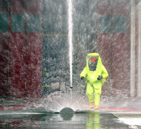 hazardous waste: man with yellow protective gear against biological risk Stock Photo
