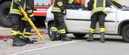firetruck: road accident with car parts and the firetruck