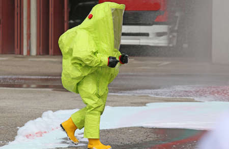 chemical warfare: man with yellow protective gear against biological risk Stock Photo