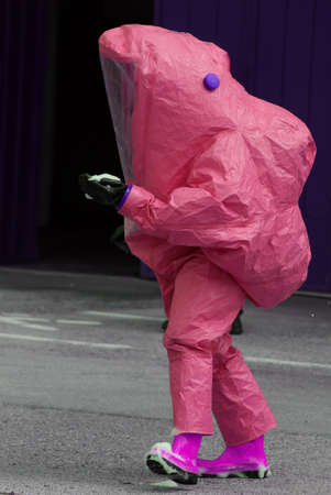 man with yellow protective gear against biological risk Stock Photo