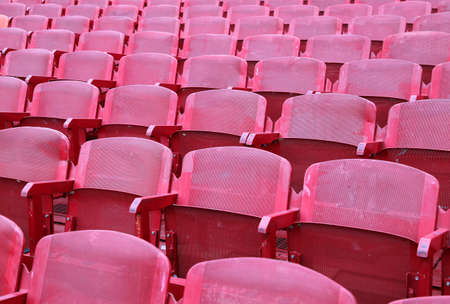 red empty chairs in the stadium before the show Stock Photo