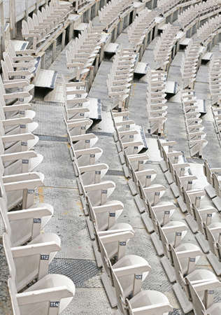 sporting event: many empty seats in the stands before the sporting event