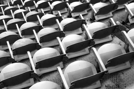 sporting event: gray empty seats in the stands before the sporting event