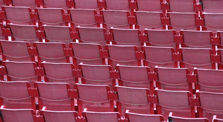 absenteeism: red empty chairs in the stadium before the show Stock Photo