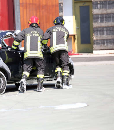 road accident: firemen in action during the road accident Stock Photo