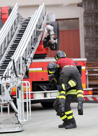 accident fire truck: firefighters in the fire truck basket during the practice of training in fire station Stock Photo