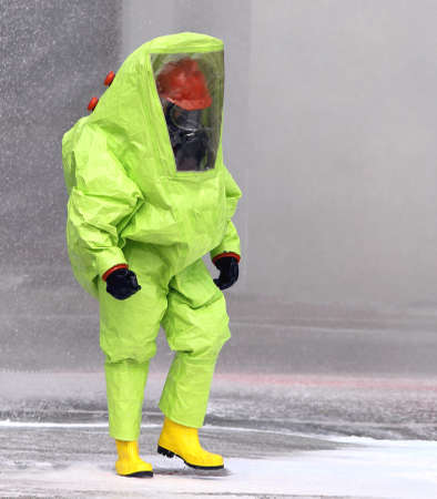 man with yellow protective suit photo