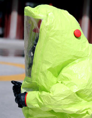 man with yellow protective gear against biological risk 版權商用圖片