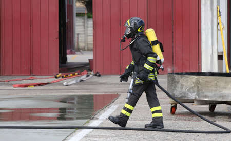 firefighter: Firefighters in uniform in the barracks of the fire brigade.