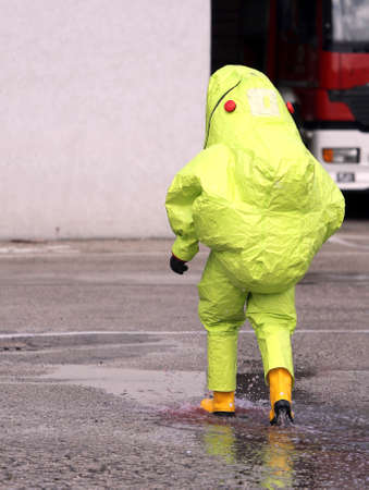 radiation protection suit: man with yellow protective gear against biological risk Stock Photo