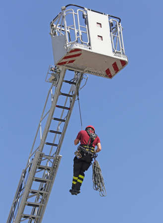 rappel: expert firefighters hung the rope climbing during the practical exercise in fire station Stock Photo