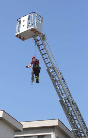 rappelling: firefighters hung the rope climbing during the practical exercise in firehouse