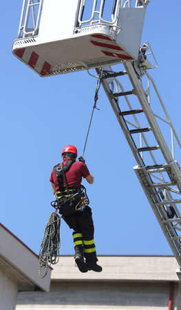 hung: firefighters hung the rope climbing during the practical exercise
