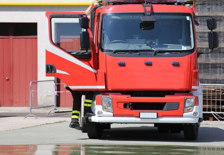 PUMPER: red fire engine in the barracks of the fire brigade after the fire tutorial