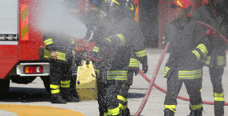 fireman: firefighters with the fire extinguisher during a practice session at Fire Station