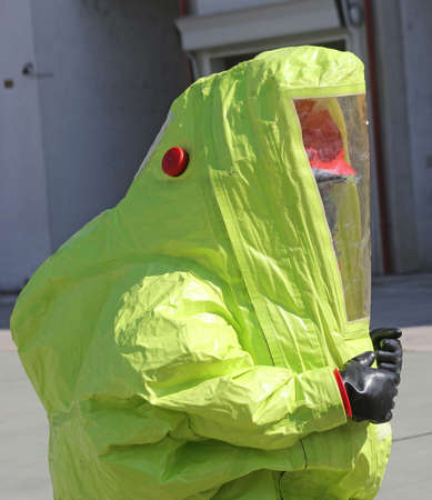 hazmat: person with yellow protective suit to work in presence of asbestos