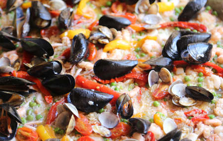 Valencian Paella rice with clams and mussels and green peas Stock fotó
