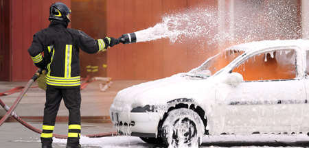 fireman: fireman extinguished the fire with foam fighting