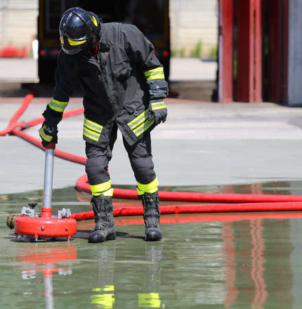 rescuer: Firefighter positions a powerful fire hydrant during the exercises
