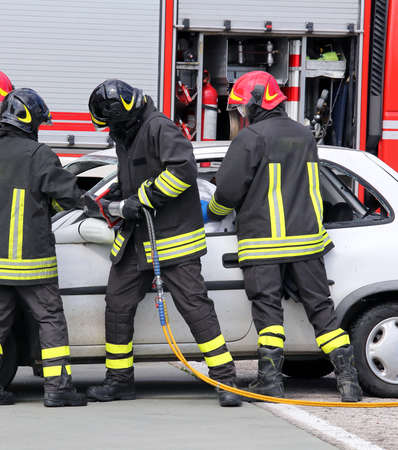 relieve: firefighters relieve an injured after an accident during a practice session in the fire station Stock Photo