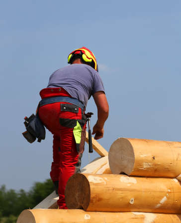 safely: Carpenter with helmet to work safely on the roof of the House