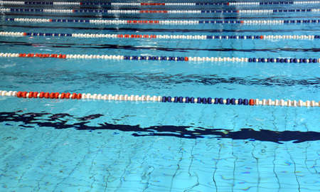 lane marker: lanes for swimming pool with blue water Stock Photo