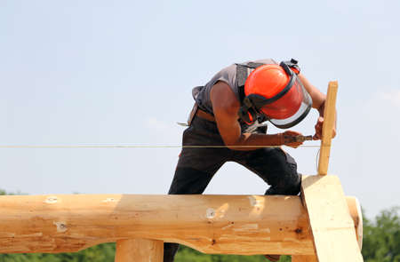 ppe: Carpenter with helmet and protective equipment to work safely Stock Photo
