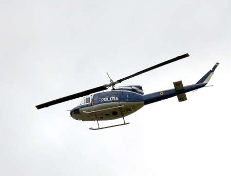fling: Italian police helicopter flying over the city during a control