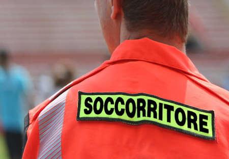 rescuer: italian rescuer with orange uniform at sporting event Stock Photo