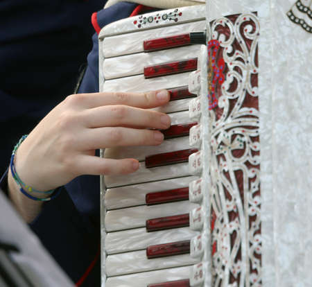 plays: young woman plays the ancient accordion keyboard