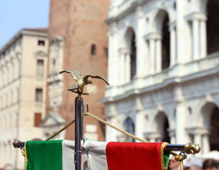 fanfare: italian flag of army musical band and the Palladian Basilica in Vicenza Stock Photo