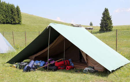 boy scouts tent: One tent of a campsite of the boy scouts in the mountains in summer Stock Photo