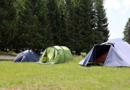 boy scouts tent: boy scout camp with three tents Stock Photo