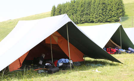 boy scouts tent: big tent of boy scout camp with backpacks and sleeping bags spread out