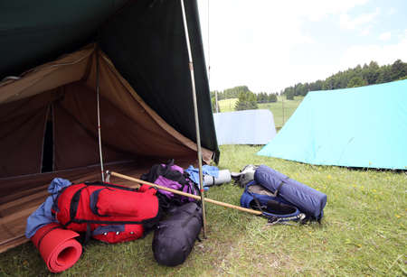 boy scouts tent: tent and backpacks and sleeping bags outside