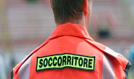rescuer: italian rescuer with orange uniform at stadium