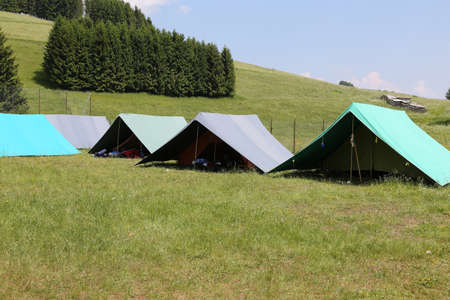 boy scouts tent: tents of a campsite of the boy scouts in the mountains in summer