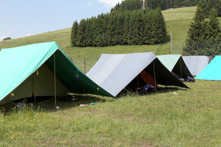 boy scouts tent: tents of a campsite of the boy scouts in the mountains Stock Photo