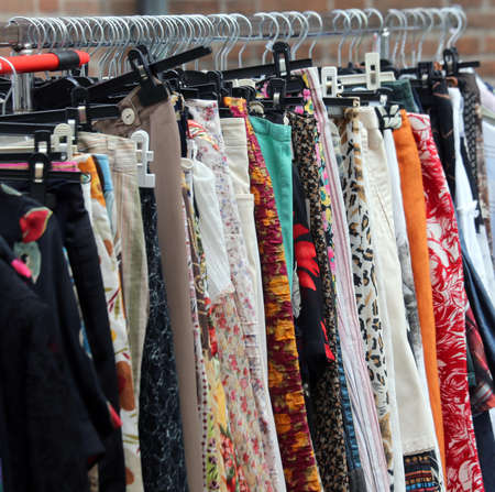 used clothes: vintage clothes hanging in the market of used things Stock Photo
