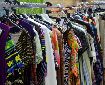 used clothes: vintage clothes hanging in the open flea market Stock Photo