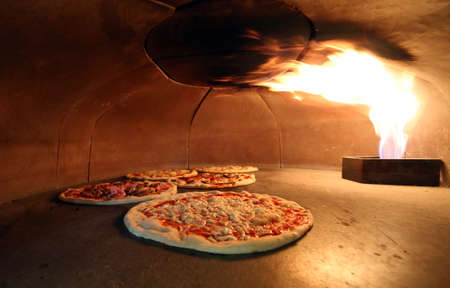 gas fireplace: Tasty pizzas in the oven with the flame