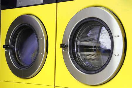 washing machines: two large washing machines in laundromats